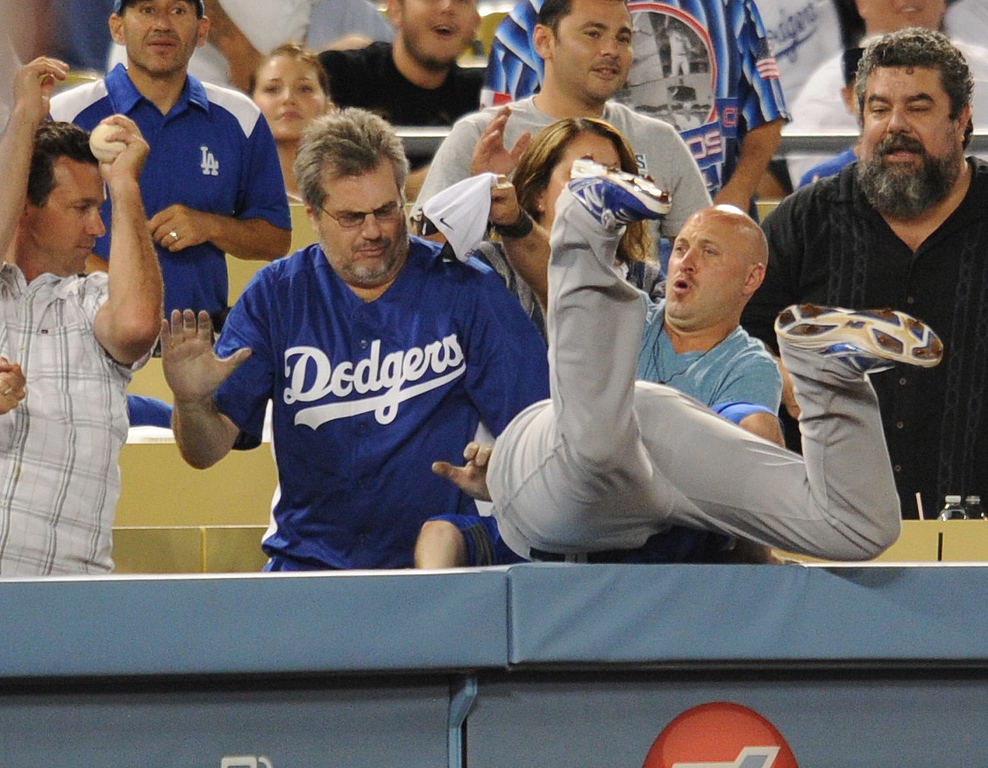 . Cubs Donnie Murphy goes for a foul ball, but gets robbed by a fan. The Cubs defeated the Dodgers 3-2 in a game at Dodger Stadium. Los Angeles, CA. 8/27/2013 (John McCoy/LA Daily News)