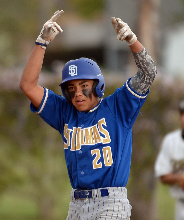 . San Dimas\' David Vargas reacts after a two run double in the sixth inning of a prep baseball game against Northview at Northview High School in Covina, Calif., on Wednesday, March 26, 2014. San Dimas won 2-0. (Keith Birmingham Pasadena Star-News)