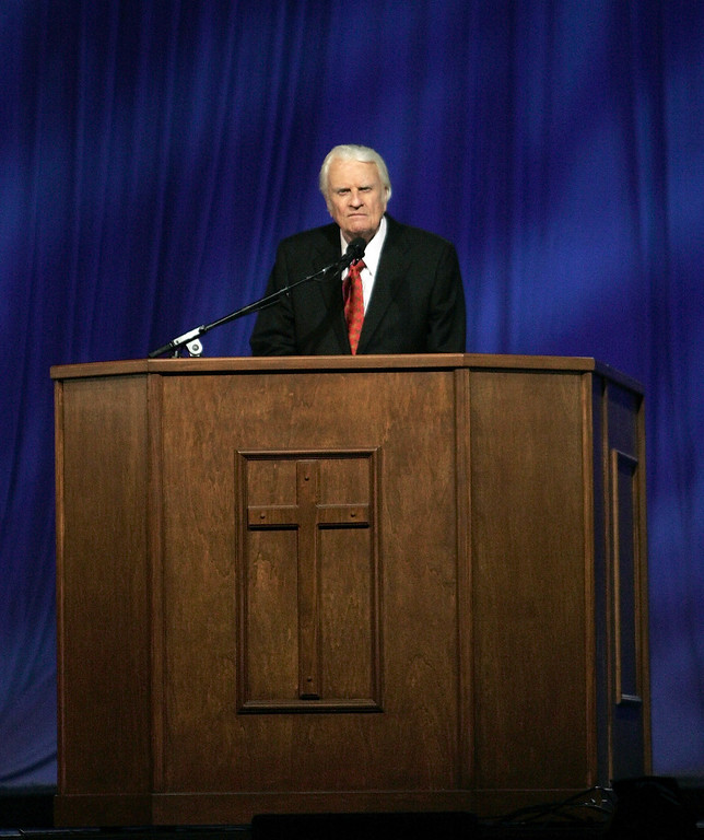 . The Rev. Billy Graham preaches at a service in New Orleans Sunday evening March 12, 2006.  (AP Photo/Bill Haber)