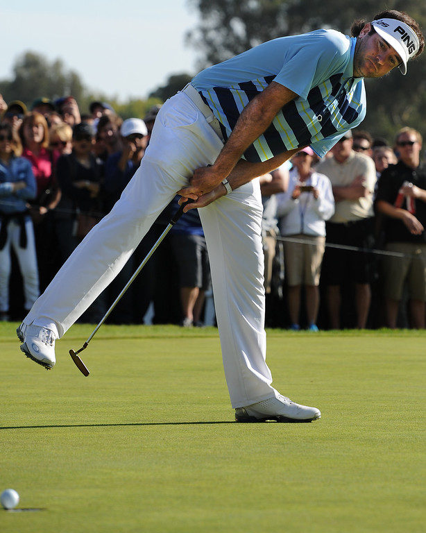 . Bubba Watson tips over to see his put on 18 fall in for birdie. Watson won the 2014 Northern Trust Open with a score of 15 under par.  Pacific Palisades, CA. February 16, 2014 (Photo by John McCoy / Los Angeles Daily News)