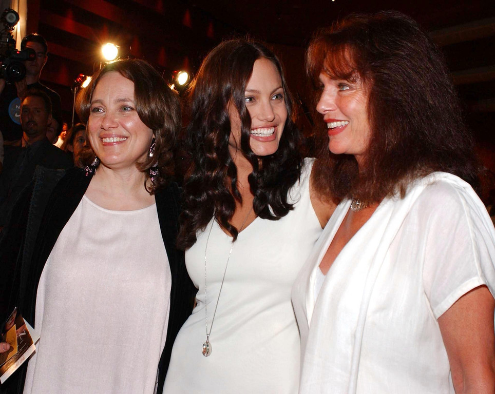 ". WEST HOLLYWOOD, UNITED STATES:  US actress Angelina Jolie (C) chats with her mother Marcheline Bertrand (L) and British actress Jacqueline Bisset (R) at the premiere of her new film ""Original Sin\"", in West Hollywood, CA, 31 July 2001. Jolie stars in the sexual thriller with Spanish actor Antonio Banderas.  (LUCY NICHOLSON/AFP/Getty Images)"