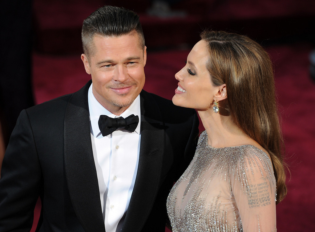 . Brad Pitt and Angelina Jolie attend the 86th Academy Awards at the Dolby Theatre in Hollywood, California on Sunday March 2, 2014 (Photo by John McCoy / Los Angeles Daily News)