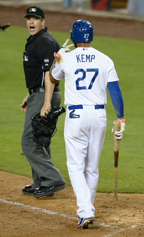 . Matt Kemp has words with home plate umpire Chris Segal after being called out on strikes in the 8th inning. The Dodgers defeated the Angels 5-4. Los Angeles, CA. 8/5/2014(Photo by John McCoy Daily News)