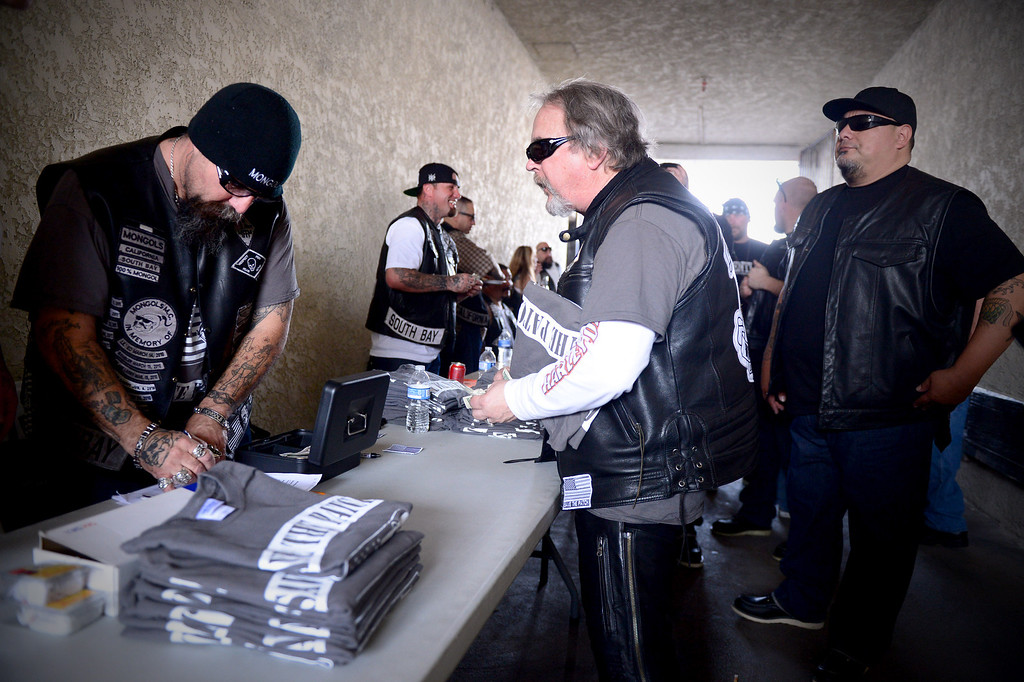 ". ""Save the Patch\"" t-shirts are sold as motorcycle club members rally Saturday, March 29, 2013 at The House Lounge in Maywood in support of the Mongols who are facing a federal trial seeking to take away their trademark patch. (Photo by Sarah Reingewirtz/Pasadena Star-News)"
