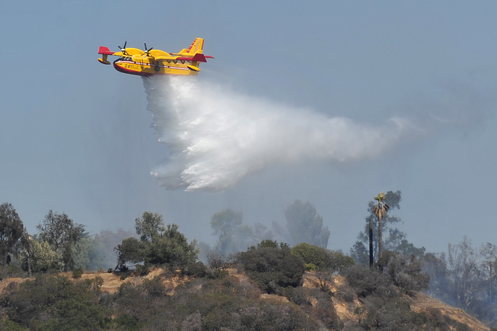 . A Super Scooper drops water as Los Angeles County and La Verne Fire Department\'s work to extinguish a 6.9 acre brush fire in La Verne on Friday September 13, 2013. (Whittier Daily News/Staff Photo by Keith Durflinger)