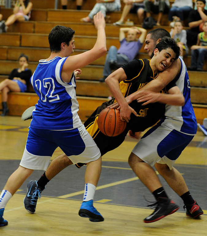 . Shant #5 Evan Ohanessian is fouled by Ararat #33 Gevork Sarkissian while Ararat #12 Tigran Ghukasyan joins in on the play.  The months-long Homenetmen Navasartian Games, an Armenian athletic competition that involves thousands of competitors, concluded Saturday at Birmingham High School in Van Nuys, CA. 7/6/2013(John McCoy/LA Daily News)