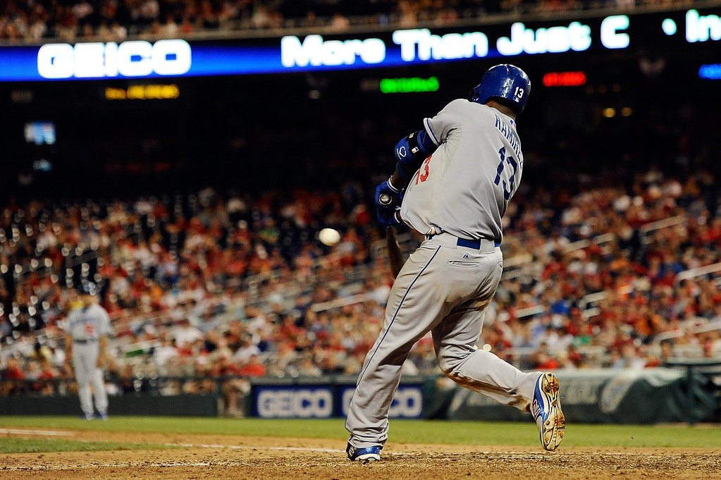 . Hanley Ramirez #13 of the Los Angeles Dodgers hits a RBI double scoring Adrian Gonzalez #23 (not pictured) in the tenth inning of a game against the Washington Nationals at Nationals Park on July 20, 2013 in Washington, DC. The Los Angeles Dodgers defeated the Washington Nationals 3-1. (Photo by Patrick McDermott/Getty Images)