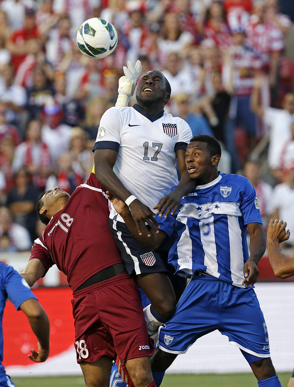 . United States\' Jozy Altidore (17) heads the ball as Honduras\' goalie Noel Valladares (18) and teammate Jose Velasquez (5) defend in the second half during a World Cup qualifying soccer match at Rio Tinto Stadium on Tuesday, June 18, 2013, in Sandy, Utah. The United States defeated Honduras 1-0.  (AP Photo/Rick Bowmer)