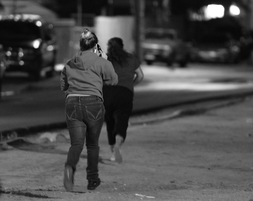 . Family members of a man who was arrested for solicitation hastily leave the scene and head for home. When they saw police activity, they ran to see what was happening with their family member who was being arrested.  LAPD Police Officers from the Foothill Station participated in a sting operation with a female decoy officer portraying a prostitute. Sun Valley, CA. 3/6/2014(Photo by John McCoy / Los Angeles Daily News)