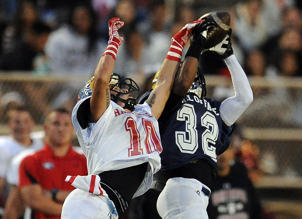. West\'s Ezra Broadus (32) (Alhambra) catches a pass in front of East\'s Jesus Arteaga (10) ( Azusa) in the first half of the annual East vs. West San Gabriel Valley Hall of Fame all-star football game at West Covina High School on Friday, May 17, 2013 in West Covina, Calif.  (Keith Birmingham Pasadena Star-News)