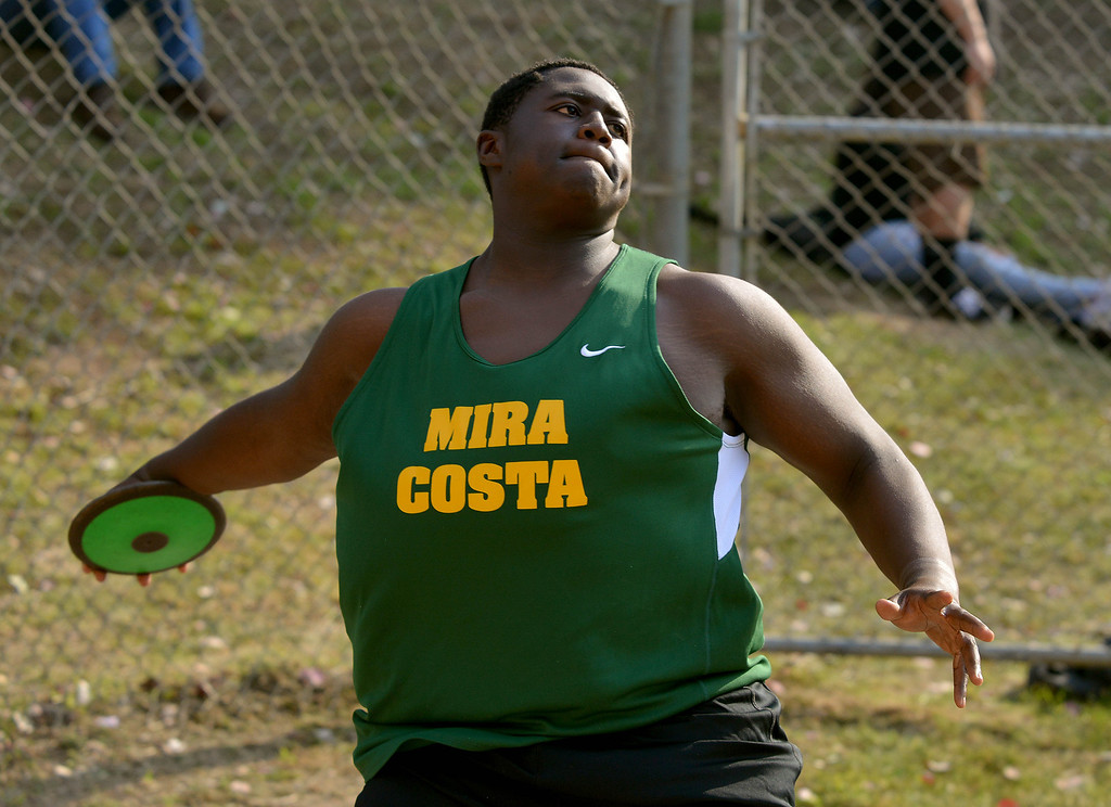 . 05-03-2013-(LANG Staff Photo by Sean Hiller)-  The Bay League track and field finals Friday night at Mira Costa High School. Khalil Sonko in the disc competition.