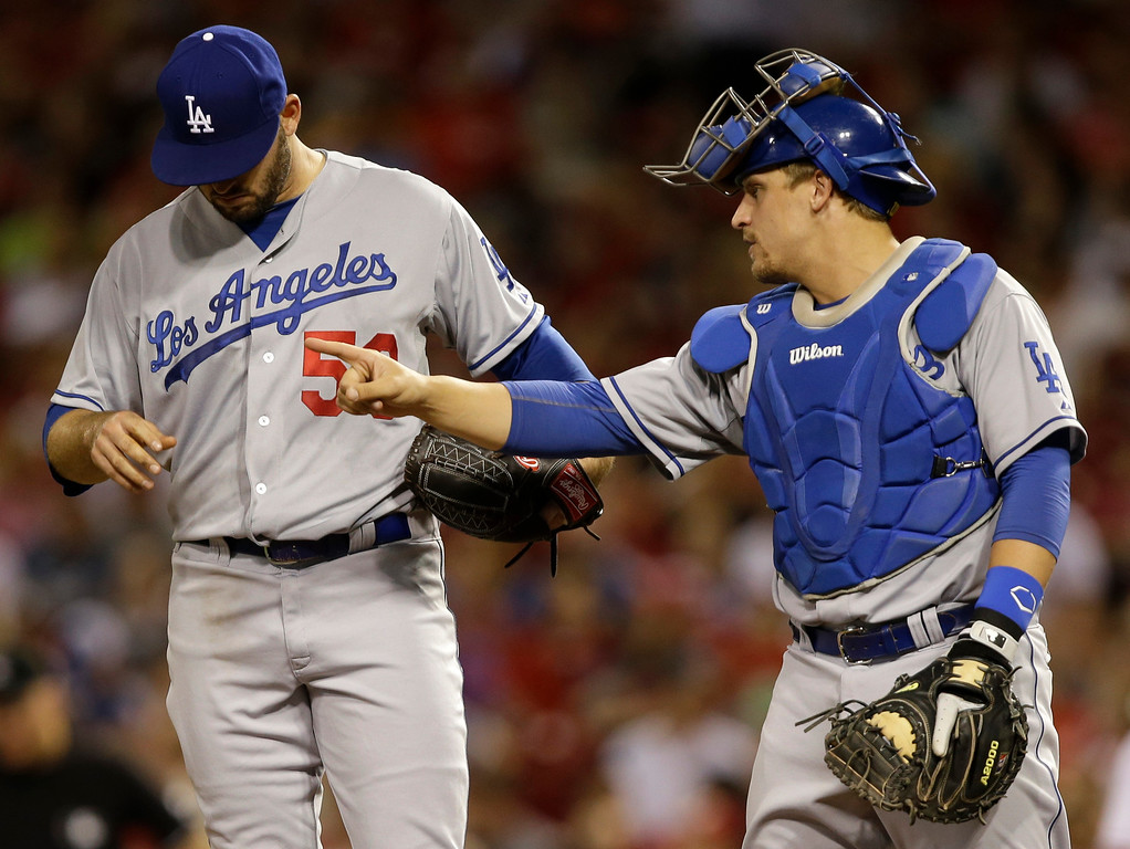 . Los Angeles Dodgers relief pitcher Stephen Fife (59) talks with catcher Tim Federowicz in the fourth inning of a baseball game against the Cincinnati Reds, Friday, Sept. 6, 2013, in Cincinnati. (AP Photo/Al Behrman)