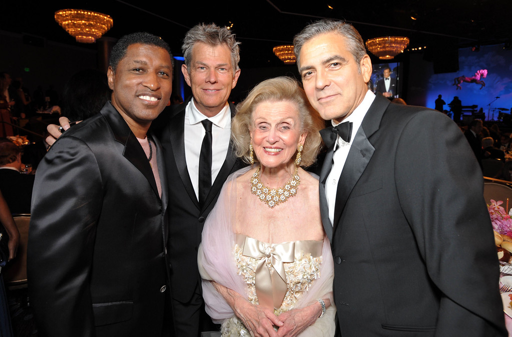 """. From left, Kenneth  \""""Babyface\"""" Edmonds, David Foster,  Barbara Davis, and George Clooney attend The Carousel of Hope at The Beverly Hilton Hotel on Saturday, Oct. 20, 2012, in Beverly Hills. (Photo by John Shearer/Invision/AP)"""