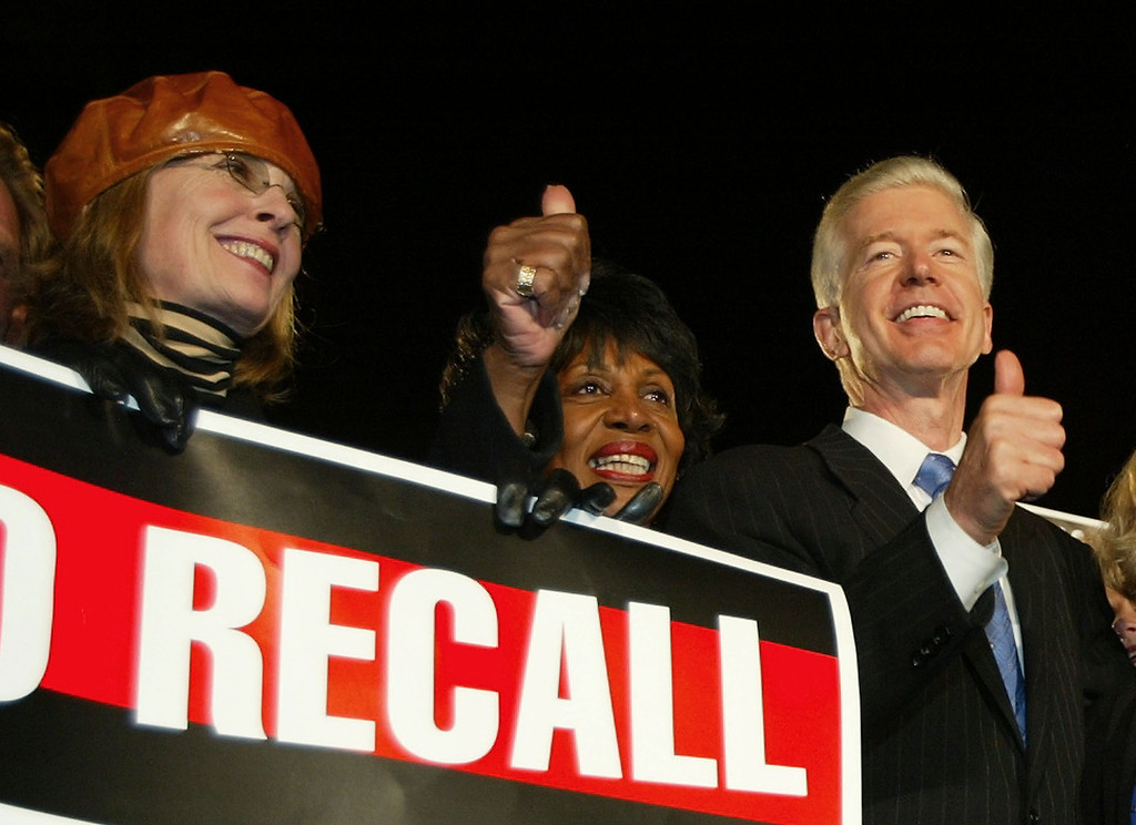 . California Gov. Gray Davis, right, flashes thumbs up with actress Diane Keaton and Congresswoman Maxine Waters, D-Calif. during the get out the vote rally Monday, Oct. 6, 2003, on the eve of the California recall election. (AP Photo/Kevork Djansezian)