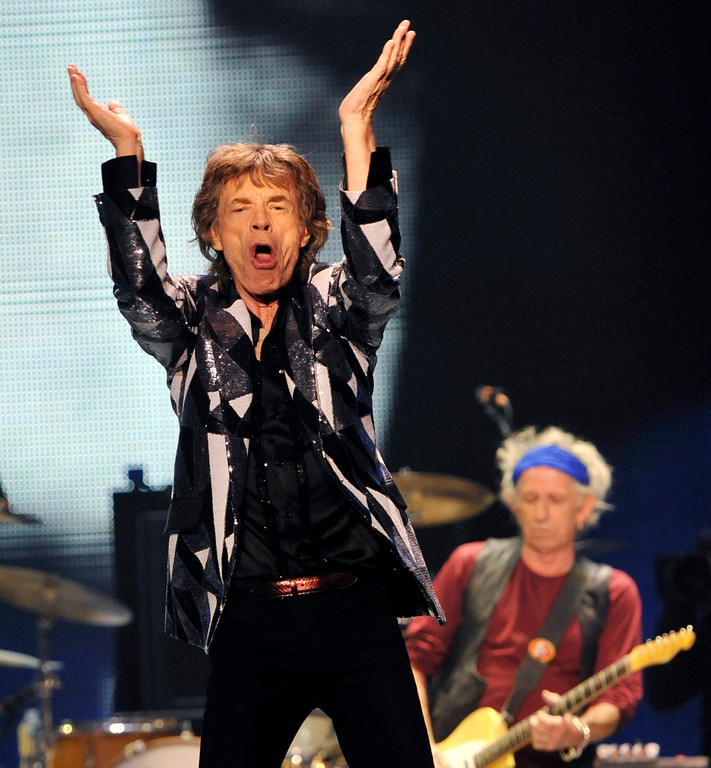 ". Mick Jagger, left, and Keith Richards of the Rolling Stones perform on the kick-off of the band\'s ""50 and Counting\"" tour at the Staples Center on Friday, May 3, 2013 in Los Angeles. (Photo by Chris Pizzello/Invision/AP)"