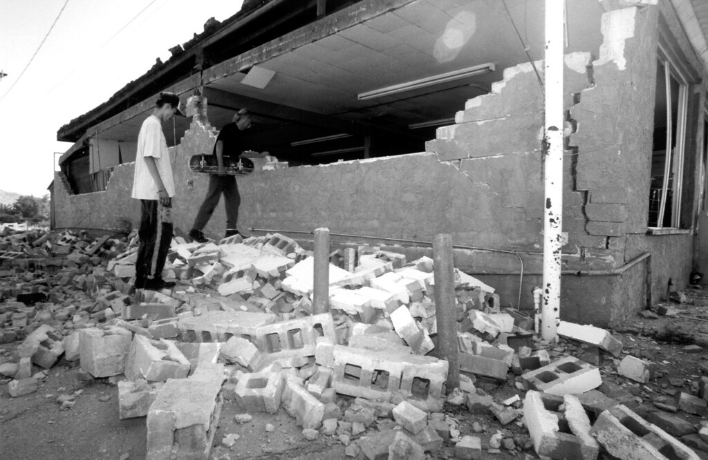 . June 28, 1992: John Tolliver, with skateboard, looks over what remains of Monument Market in Joshua Tree.  Daily News file photo