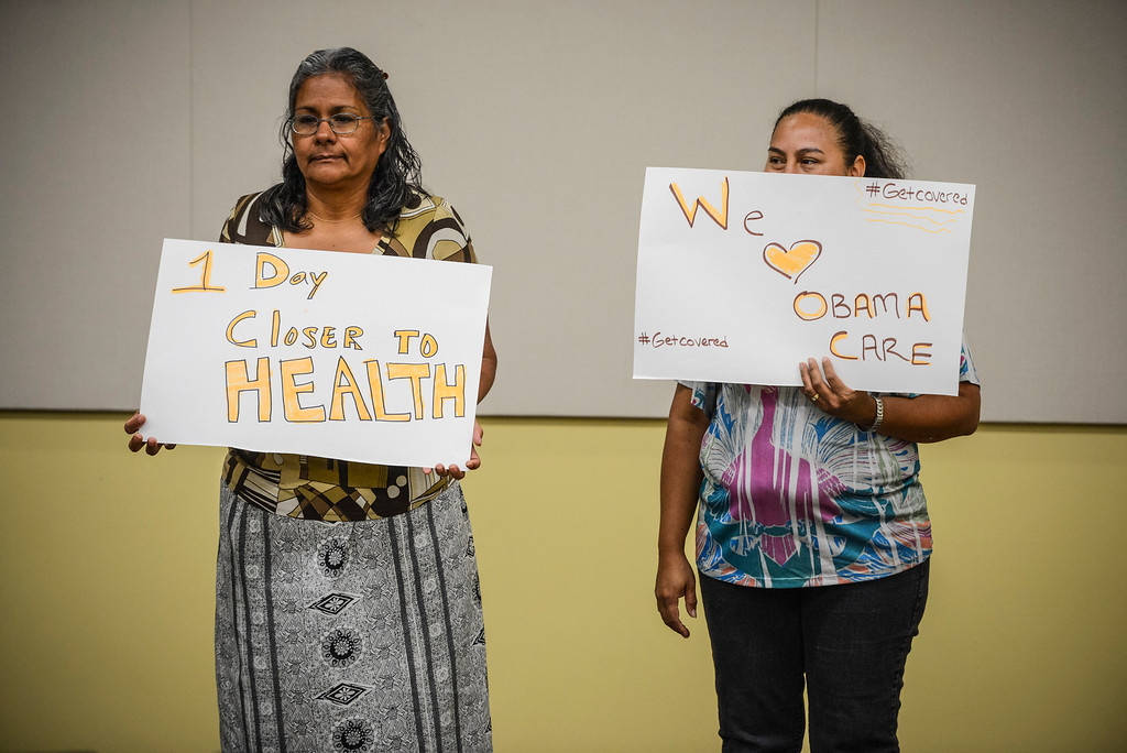 . Clients hold Obama Care signs at the St. John\'s Well Child & Family Center in Los Angeles, CA Monday, September 30, 2013.  St. John\'s held a media event to praise the arrival of Obama Care October 1st.  (Photo by David Crane/Los Angeles Daily News)