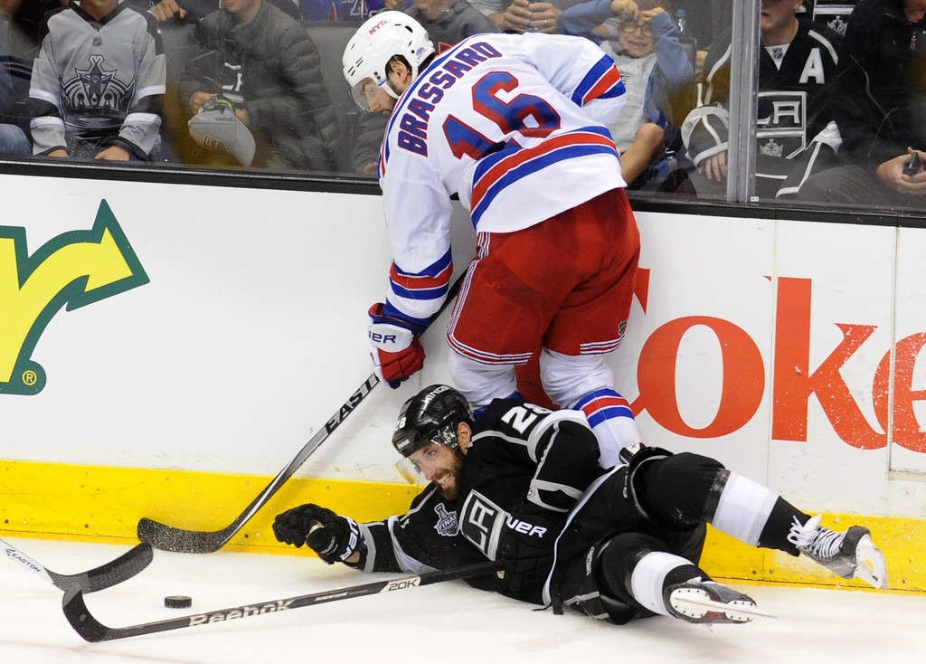 . Kings#28 Jarret Stoll finds himself on the ice while battle in for the puck with Rangers#16 Derick Brassard in tyne first OT period. The Los Angeles Kings faced the New York Rangers in game 2 of the Stanley Cup Final.  Los Angeles, CA. 6/7/2014(Photo by John McCoy Daily News)