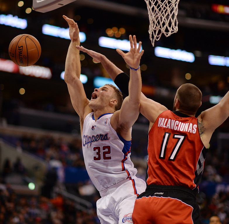 . The Clippers� Blake Griffin #32 is fouled by the Raptors� Jonas Valanciunas #17 during their game at the Staples Center in Los Angeles Friday, February 7, 2014. (Photo by Hans Gutknecht/Los Angeles Daily News)