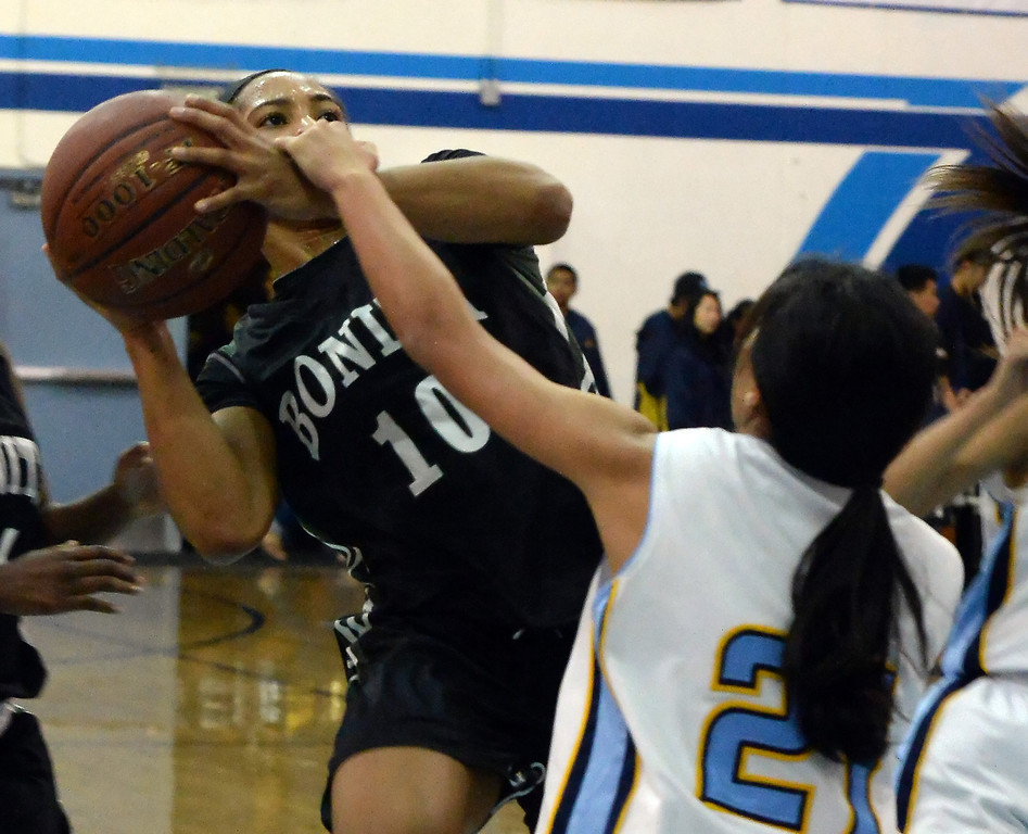 . Bonita\'s Nikki Wheatley (C) (10) drives to the basket against Walnut in the first half of a prep basketball game at Walnut High School in Walnut, Calif., on Wednesday, Jan. 15, 2014. Bonita won 60-50. (Keith Birmingham Pasadena Star-News)