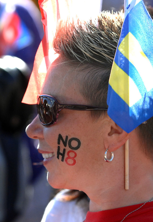 """. Michelle Lewis wears a \""""NOH8\"""" decall at a rally in West Hollywood to celebrate the U.S. Supreme Court\'s ruling that killed Prop 8, Wednesday, June 26, 2013. (Michael Owen Baker/L.A. Daily News)"""