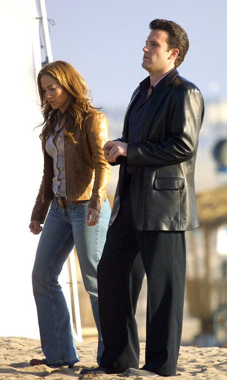 ". Actor Ben Affleck and actress/singer Jennifer Lopez film a scene on the set of ""Gigli\"" at Will Rodgers Beach on January 12, 2003 in Pacific Palisades, California.  (Photo by Ben-Ari Finegold/Getty Images)"