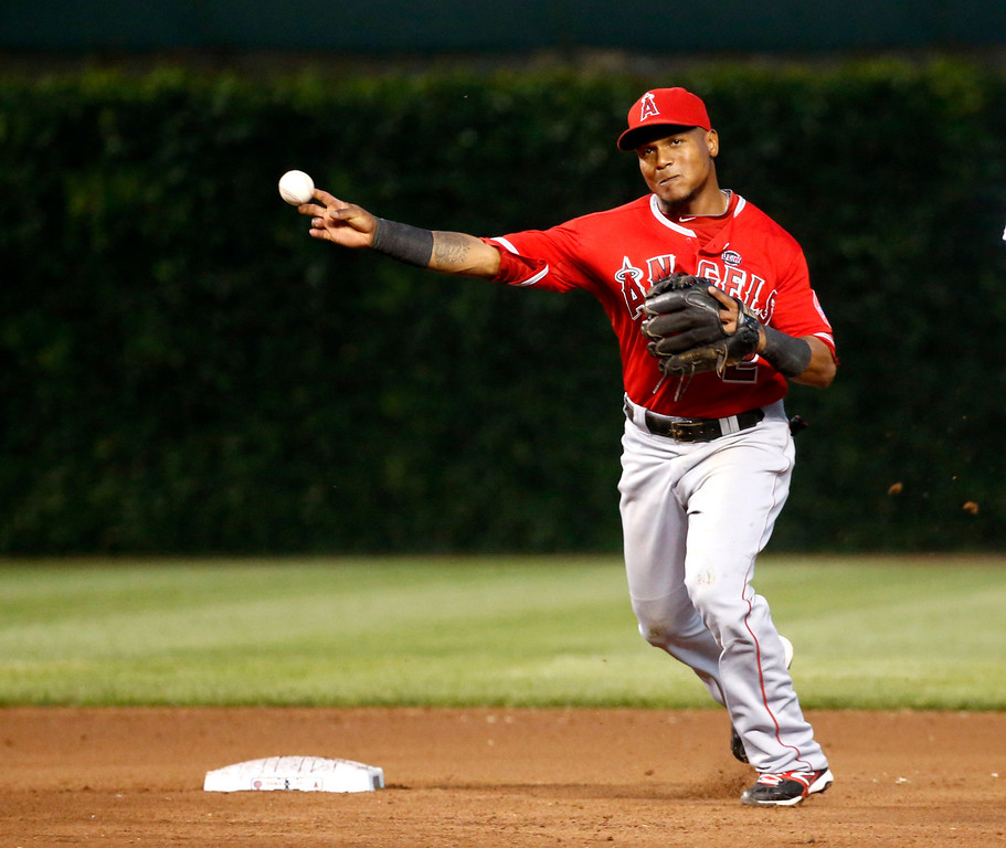 . Los Angeles Angels shortstop Erick Aybar turns the double play forcing Chicago Cubs\' Anthony Rizzo at second and getting Starlin Castro at first during the fourth inning of an interleague baseball game Wednesday, July 10, 2013, in Chicago. (AP Photo/Charles Rex Arbogast)