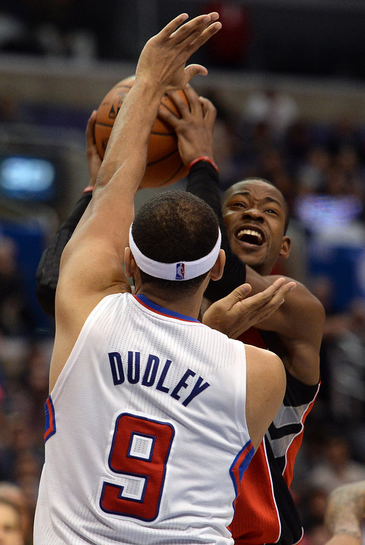 . The Raptors� Terrence Ross #31 looks to shoot as the Clippers� Jared Dudley #9 defends during their game at the Staples Center in Los Angeles Friday, February 7, 2014. (Photo by Hans Gutknecht/Los Angeles Daily News)