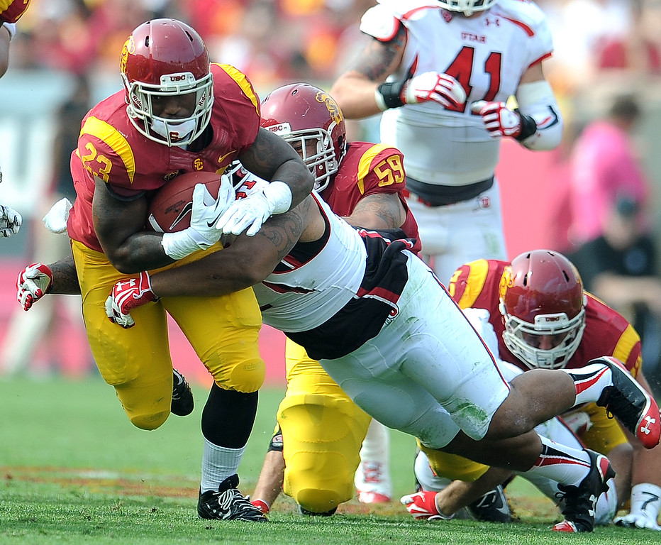 . Southern California running back Tre Madden (23) runs for a first down against Utah during the first half of an NCAA college football game in the Los Angeles Memorial Coliseum in Los Angeles, on Saturday, Oct. 26, 2013.  (Photo by Keith Birmingham/Pasadena Star-News)
