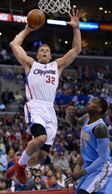 . Clippers#32 Blake Griffin goes to the hoop against Nuggets Quincy Miller. The Los Angeles Clippers took on the Denver Nuggets in a regular season NBA game. Los Angeles, CA. 4/15/2014(Photo by John McCoy / Los Angeles Daily News)