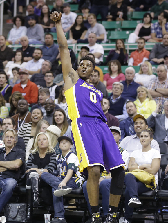 . Los Angeles Lakers Nick Young looks on after shooting a metal-pointer in the fourth quarter during an NBA basketball game against the Utah Jazz Monday, April 14, 2014, in Salt Lake City, Utah. The Lakers won 119-104. (AP Photo/Rick Bowmer)