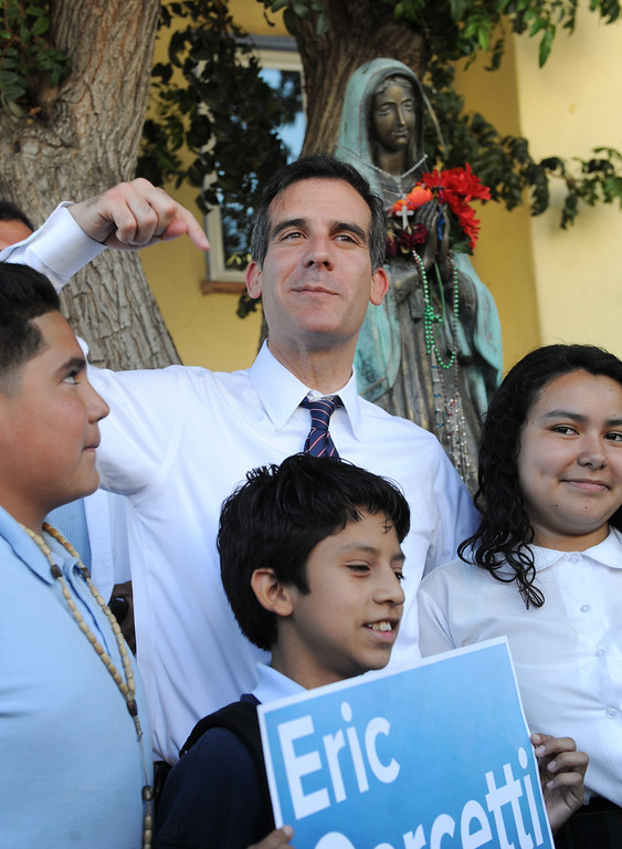 . Children have their picture taken with mayoral candidate Eric Garcetti in front of Dolores Mission Church in East Los Angeles, Monday, May 20, 2013. Garcetti used the Expo, Gold and Red metro lines to greet voters in Los Angeles. (Michael Owen Baker/Staff Photographer)