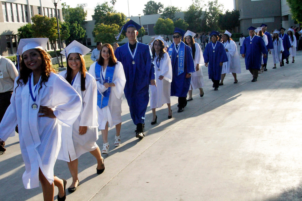 . El Monte High School graduates enter the football stadium to start the El Monte High School Class of 2014 Commencement Ceremony, at El Monte High School\'s Football Stadium in El Monte, CA., Wednesday, June 11, 2014.  (Photo by James Carbone for the San Gabriel Valley Tribune)