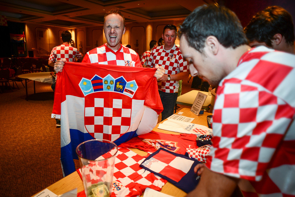 . Croatian fan George Madunovich of Glendora shows his team colors during the soccer match between Brazil and Croatia.  Croatian fans gathered at St. Anthony Croatian Catholic Church in Los Angeles for the match which was the first one of the world cup.   ( Photo by David Crane/Los Angeles Daily News )