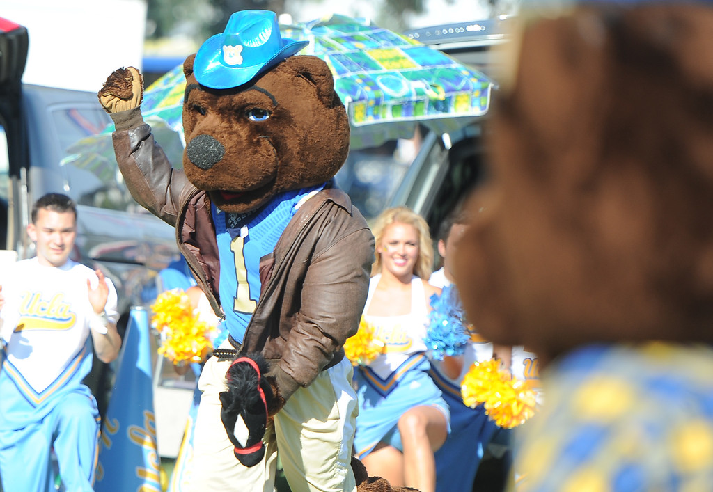 . A Bruin mascot dances to music prior to a college football game between Nevada and UCLA in the Rose Bowl on Saturday, Aug. 31, 2013 in Pasadena, Calif.    (Keith Birmingham Pasadena Star-News)
