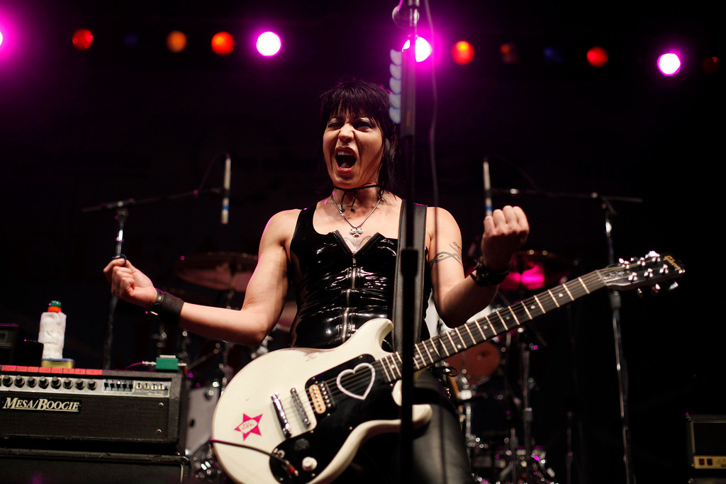 . Musician Joan Jett performs with her band, the Blackhearts during a rally in Pittsburgh, Wednesday, Sept. 23, 2009. The two-day G-20 Summit is scheduled to start Thursday in Pittsburgh. (AP Photo/Matt Rourke)