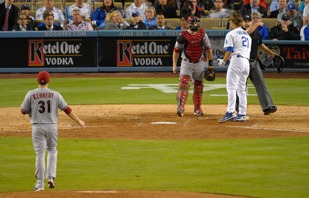 . Arizona Diamondbacks starting pitcher Ian Kennedy, left, is thrown out of the game by home plate umpire Clint Fagan, right, as catcher Miguel Montero, second from left, looks on after hitting Los Angeles Dodgers\' Zack Greinke, second from right, with a pitch during the seventh inning of their baseball game, Tuesday, June 11, 2013, in Los Angeles.  (AP Photo/Mark J. Terrill)