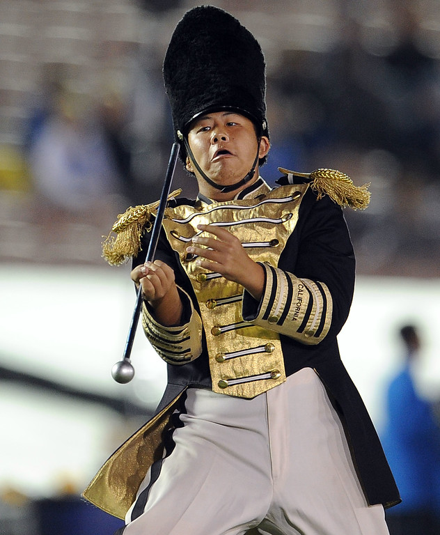 . A member of the California band twirls his baton prior to their college football game against UCLA in the Rose Bowl in Pasadena, Calif., on Saturday, Oct. 12, 2013.   (Keith Birmingham Pasadena Star-News)