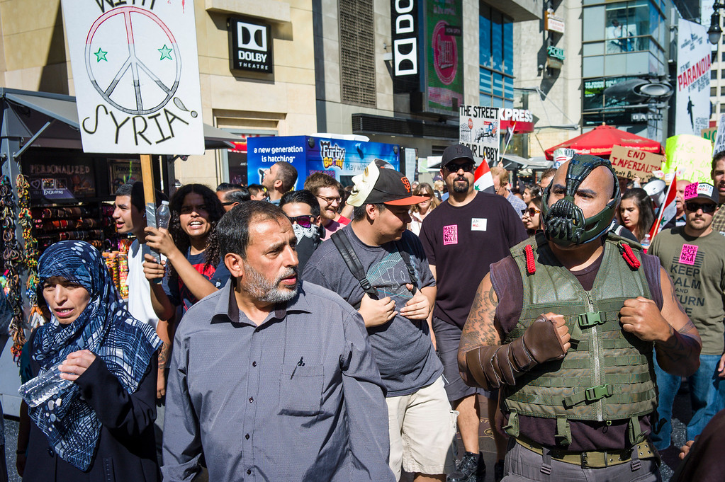 . Protestors against US involvement in Syria go head to head with movie characters along Hollywood blvd Sunday, September 8, 2013.  The protest brought out police in riot gear to try and contain the protest to the sidewalks.    ( Photo by David Crane/Los Angeles Daily News )