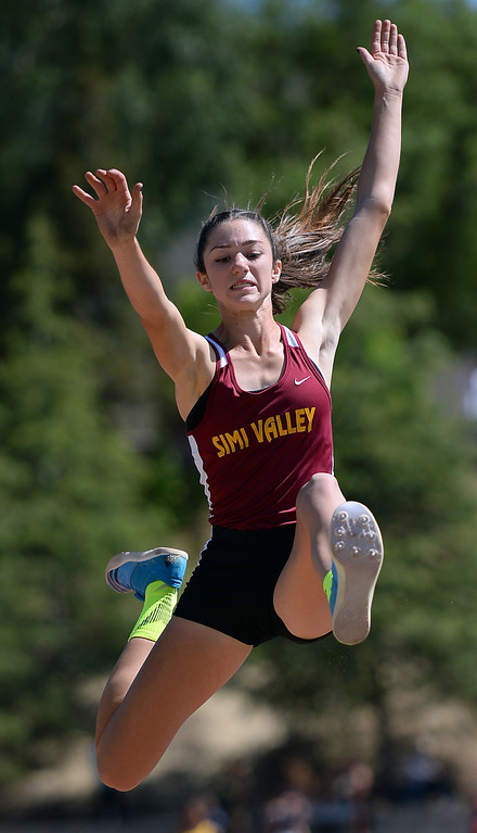 . Simi Valley High School\'s Madisen Richards competes in the long jump during the Marmonte League track and field finals May 9, 2014 in Moorpark.(Andy Holzman/Los Angeles Daily News)