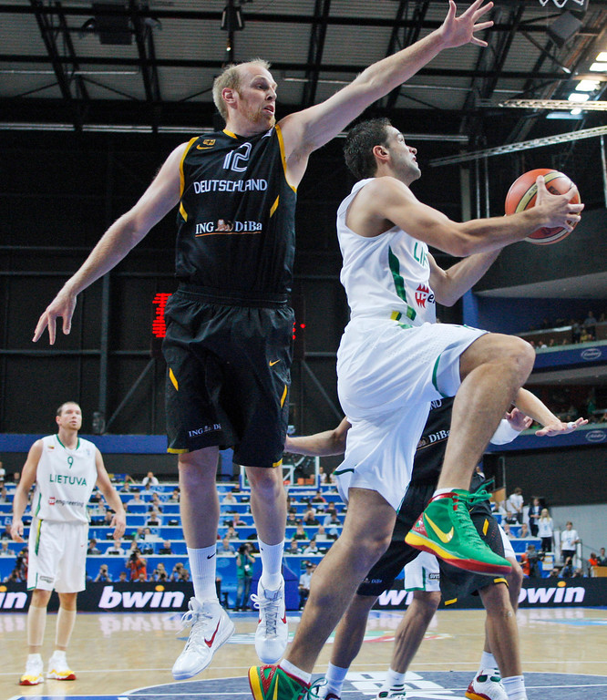 . Chris Kaman, left, from Germany tries to block Mantas Kalnietis. right, from Lithuania during the EuroBasket European Basketball Championship Group E match in Vilnius, Lithuania, Sunday, Sept. 11, 2011. (AP Photo/Petr David Josek)