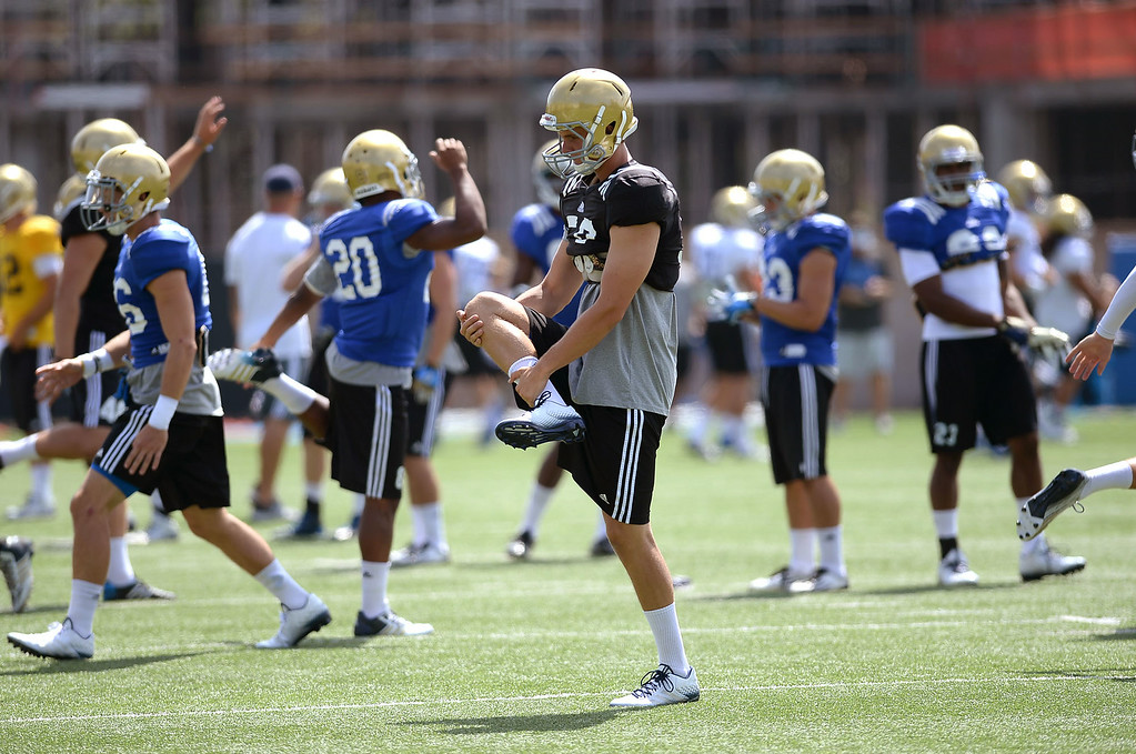 . The UCLA football team takes the field for practice at Spaulding Field Friday, August 22, 2014.(Andy Holzman/Daily News Staff Photographer)