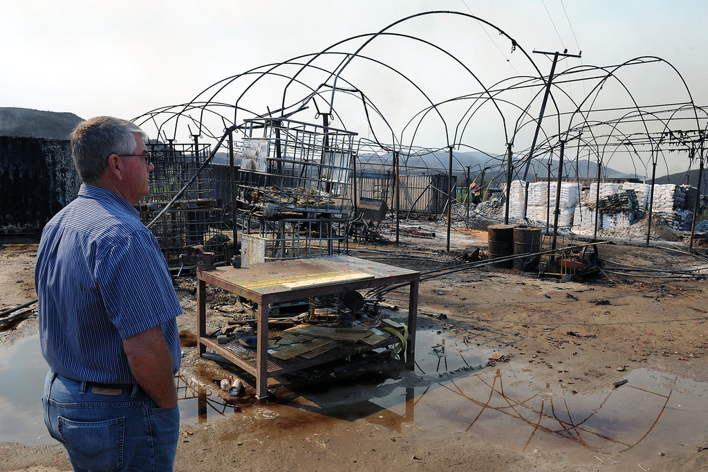 . Don Bowden, vice-president of Laguna Farms, stands in a agriculture storage yard in Camarillo that burnt Thursday from the Springs Fire, Friday, May 3, 2013. (Michael Owen Baker/Los Angeles Daily News)