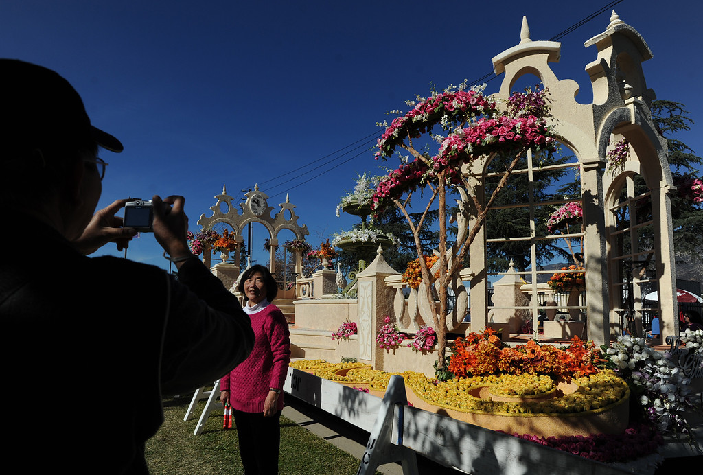 . Pictures are taken in front of the Downey Rose Float. The 125th Rose Parade\'s Showcase of Floats was staged on Sierra Madre Boulevard between Washington Boulevard and Sierra Madre Villa Avenue, and Washington Boulevard between Sierra Madre Boulevard and Woodlyn Road.  Pasadena, CA January 1, 2014.(John McCoy/Los Angeles Daily News)