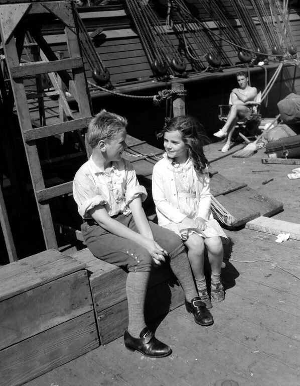 . Jackie Cooper, child film actor, shown with little Miss Ottilie Kruger, daughter of Otto Kruger, screen actor, during a location trip to Catalina Island, Calif., on Apr. 27, 1934. They are on the deck of the movie ship Histpania, achored off Emerald Bay. The director said Jackie wasn\'t paying enough attention to the camera. (AP Photo)