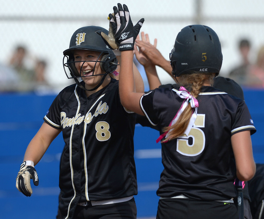 . Peninsula\'s Camille Zuliani (8) and Brooke Christensen (5) celebrate as they start the scoring against North in a first round CIF SS Division III softball game Thursday in Torrance. Peninsula won 4-1. 20130516 Photo by Steve McCrank / Staff Photographer