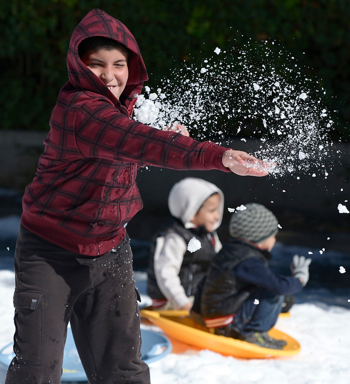 . Ruben Torosyan,9, throws snow. The Armenian Relief Society is hosting a two-day Winter Wonderland event this weekend, with snow, entertainment, games and amusement rides. Held at the Armenian Apostolic Church in Glendale. Glendale, CA. February 1, 2014 (Photo by John McCoy / Los Angeles Daily News)