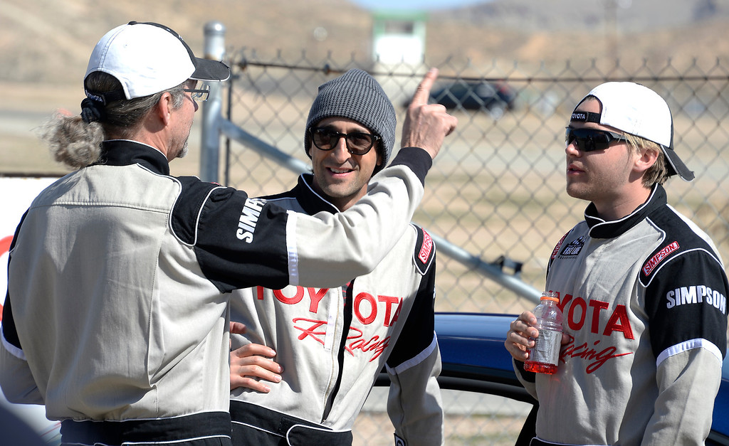 . March 15,2014. Rosamond CA. Former NASCAR racer Kyle Petty(L) talks with actors Adrien Brody(C) and Max Thieriot on their racing skills, as as they practice racing for the upcoming Long Beach Grand Prix with instructors in Toyota race cars at the Willow Springs International Raceway Saturday. Photo  by Gene Blevins/LA DailyNews