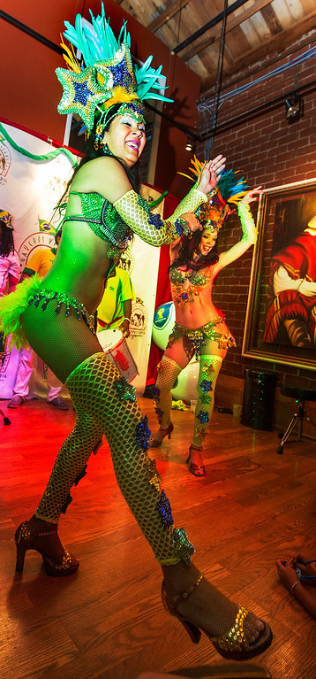 . Alessanda Comoro, left, and Isabella Grosso of Oya Brazil Samba Show perform for Brazilian fans at Gauchos Village, a Brazilian style restaurant in Glendale to party and watch live television broadcast of World Cup action between Brazil  and Croatia in the World Cup Thursday, June 12, 2014.(Photo by Walt Mancini/Pasadena Star-News)