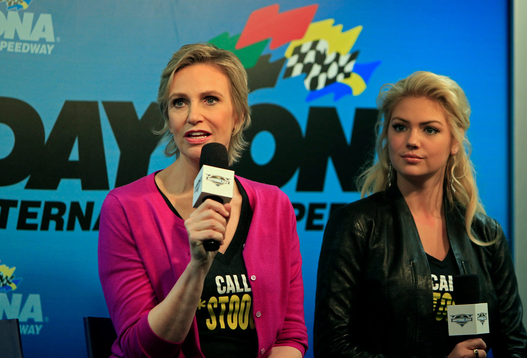 . Actresses Jane Lynch, left, and Kate Upton, right, speak to the media before the NASCAR Daytona 500 Sprint Cup series auto race at Daytona International Speedway in Daytona Beach, Fla., Sunday, Feb. 26, 2012. (AP Photo/John Raoux)